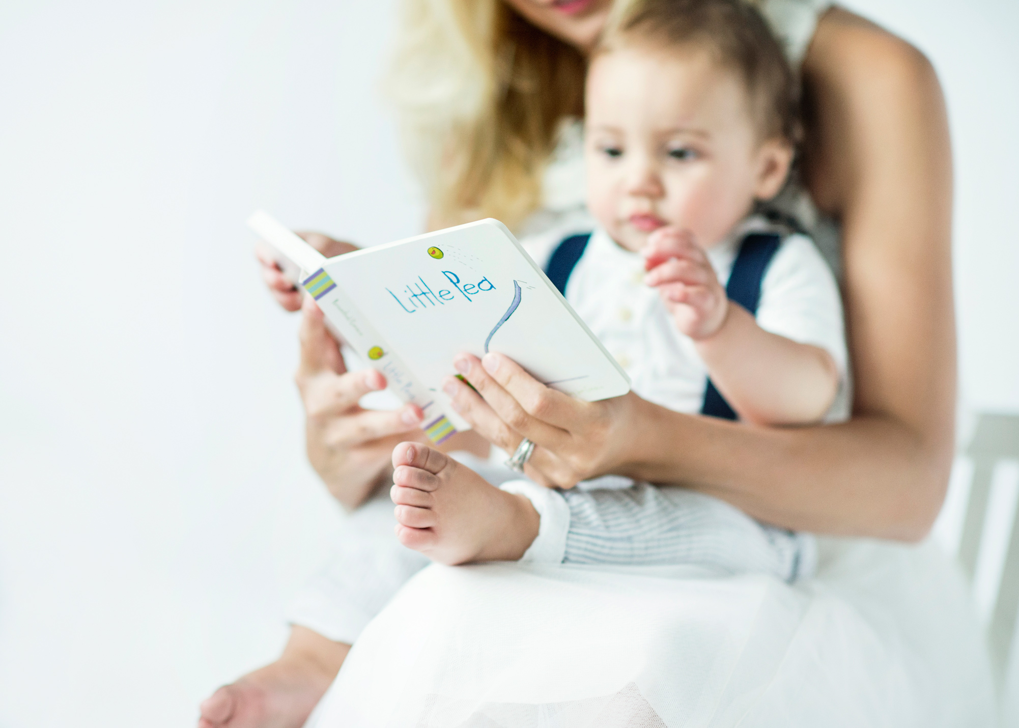 toddler reading with mom