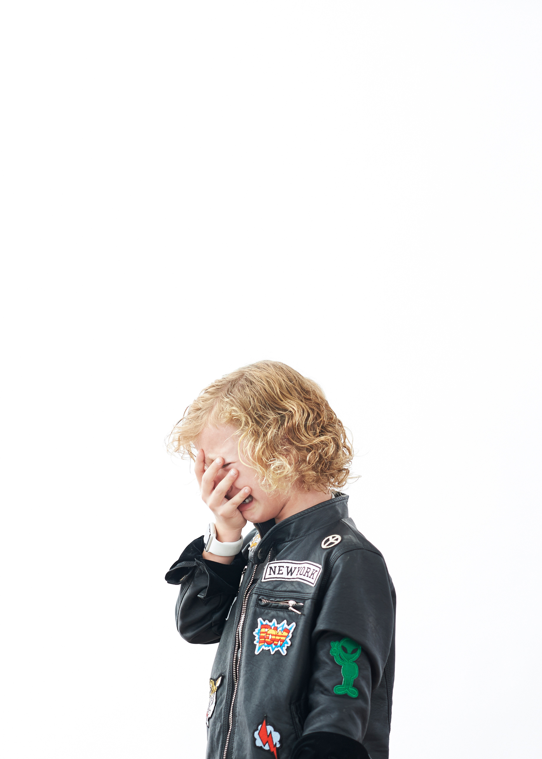 boy crying in leather motorcycle jacket