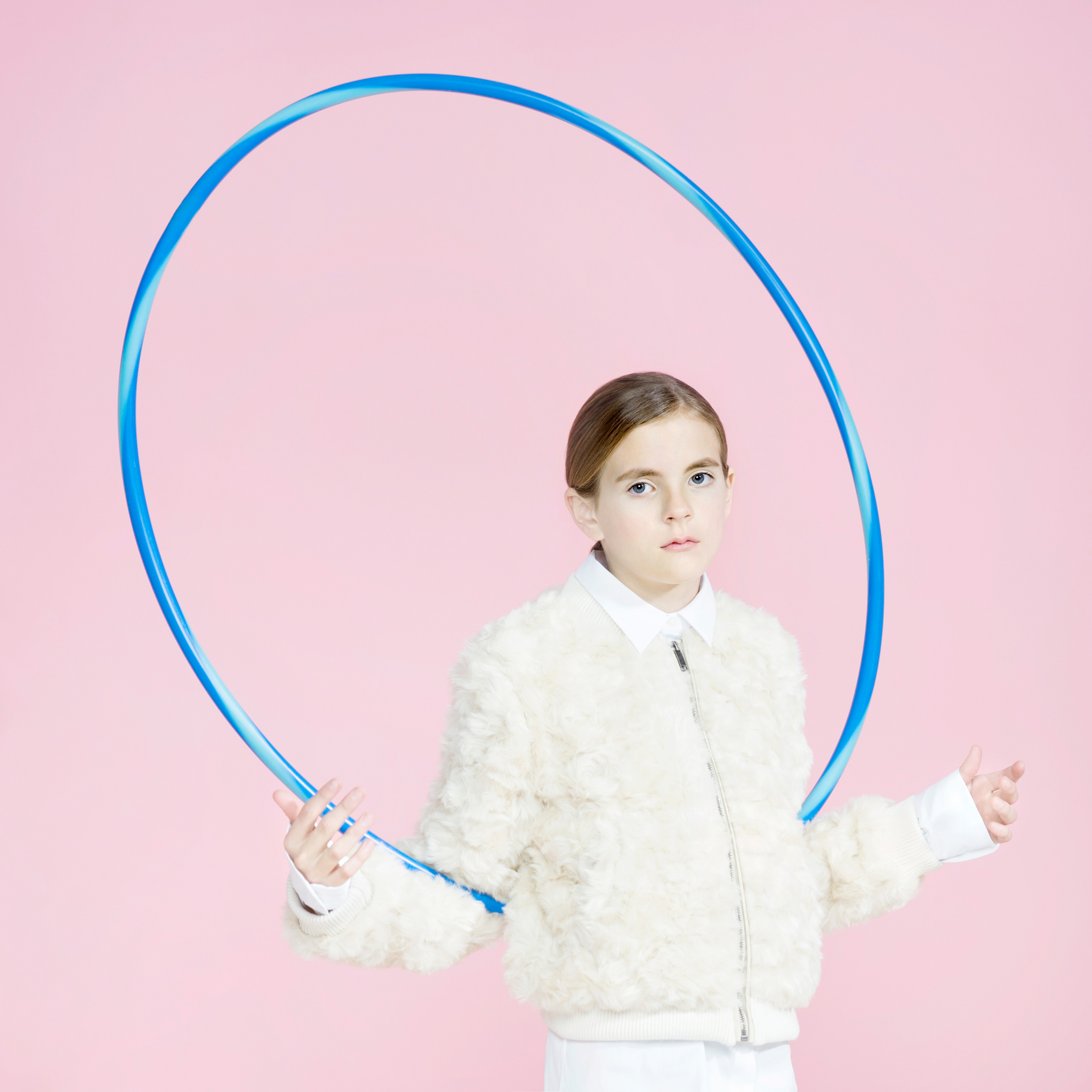 girl in fur jacket with hula hoop