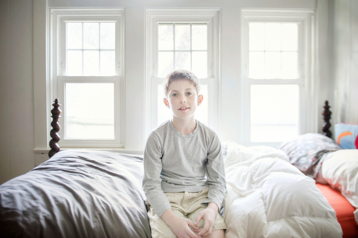 boy sitting on bed
