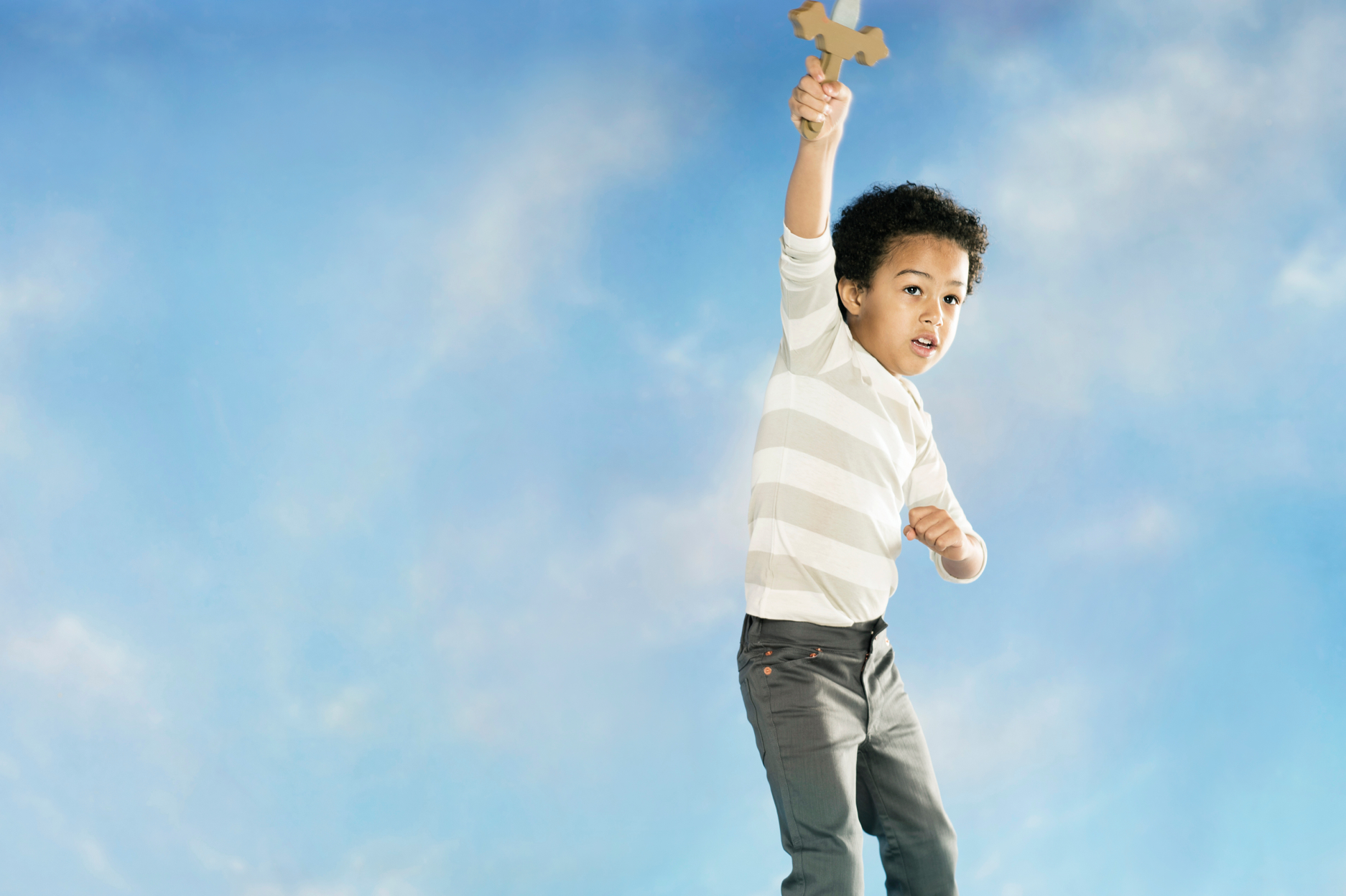 boy jumping in sky