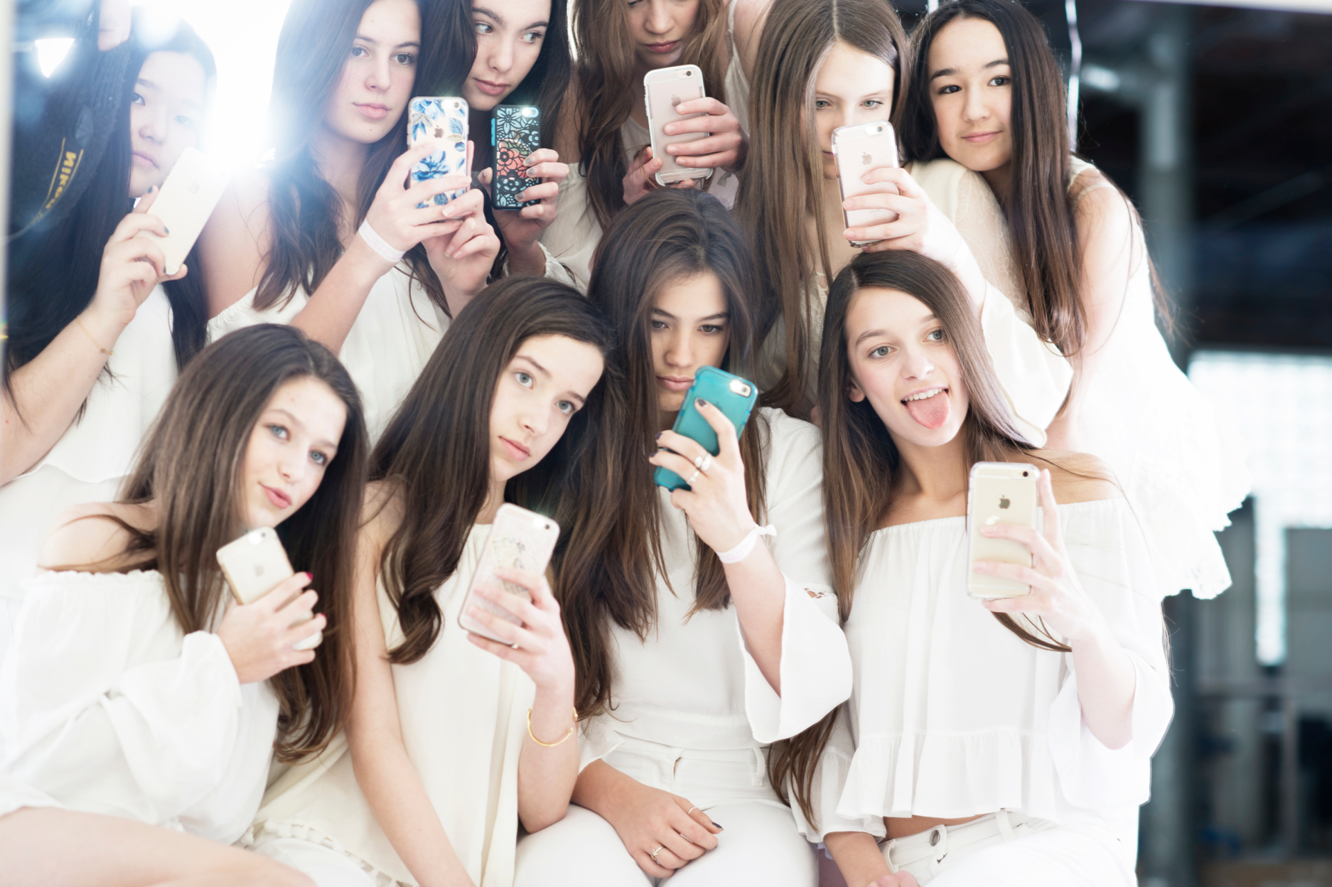 teen girls making selfies wearing white clothes