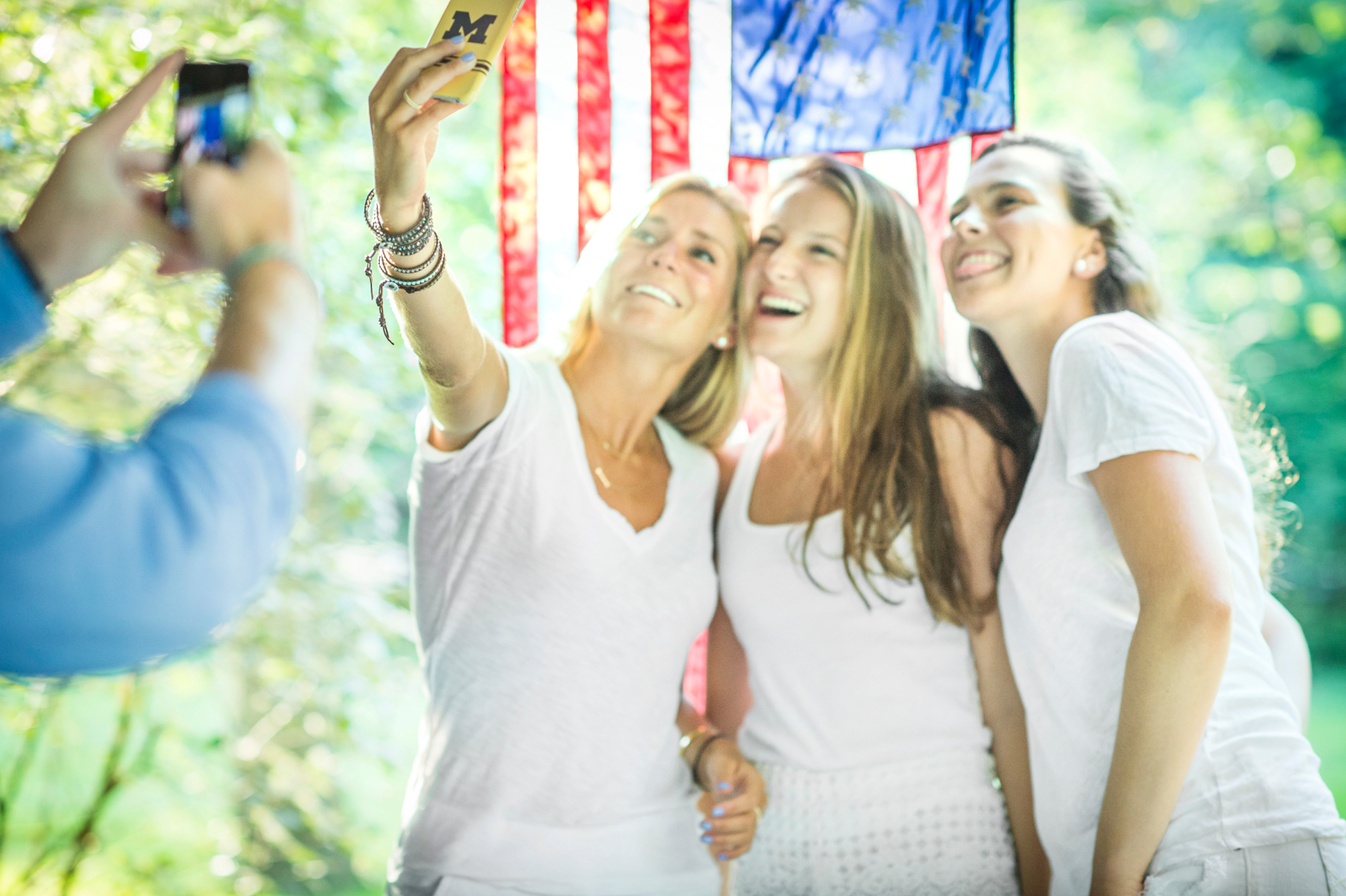 girlfriends making selfie with american flag